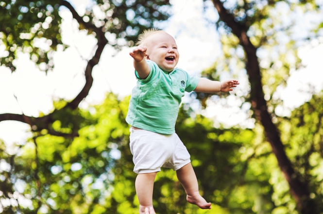 baby laughing in the air